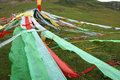 Prayer flags the tibetan at mountain slope Stock Photography