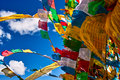 Prayer flags waving in the sky Royalty Free Stock Image