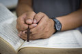 Prayer over a bible man Royalty Free Stock Photos