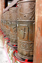 Prayer wheel fixed in the temple on the shelf by the tube Stock Photography