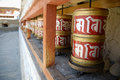 Prayer wheels in buddhist monastery red that bring good fortunes if spun clock wise Stock Photography