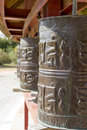 Prayer wheels in buddhist temple Royalty Free Stock Photos