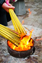 Prayers burning incense sticks on a temple fire in shanghai china Stock Images