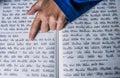 A prayers hand on a jewish bible up close Royalty Free Stock Photos