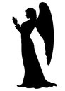 Praying angel silhouette figure of a female like a statue Royalty Free Stock Photo
