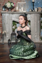Praying beautiful woman in medieval dress young green Stock Image