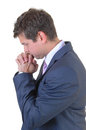 Praying businessman a young for a big decision for white background in a blue suit Royalty Free Stock Photos