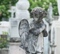 Praying concrete angel cemetery Royalty Free Stock Photo