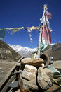 Praying flags and stones in annapurna Royalty Free Stock Photo