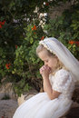 Praying girl first holy communion a young child during her Royalty Free Stock Images