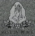 Praying hands etching with Rest in Peace inscription Royalty Free Stock Photo