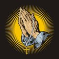 Praying hands with rosary and shining Royalty Free Stock Photo