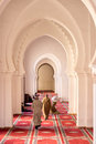 Praying Muslims inside a mosque Royalty Free Stock Photo