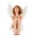 Praying teenage angel girl religion faith holidays and costumes concept Royalty Free Stock Photo