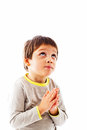 Praying to god little boy looking up Stock Photos