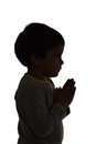 Praying to god little boy silhouette Stock Images
