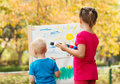Pre school children painting at the park Stock Images