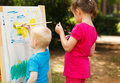 Pre school children painting at the park Stock Photo