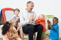 Pre School Teacher Reading Story To Children And Praying Royalty Free Stock Photo