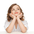 Pre teen girl in casual clothes looking up children and happy people concept picture of and thinking Stock Images