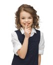 Pre teen girl showing hush gesture picture of beautiful Stock Images