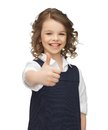 Pre teen girl showing thumbs up picture of beautiful Royalty Free Stock Image