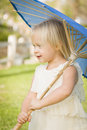 Precious Baby Girl Holding Parasol Outside At Park Royalty Free Stock Photo