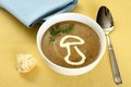 Precious mushroom cream soup with bread close up Stock Images