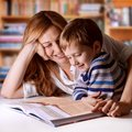 Precious time mother reading bible stories to her boy Royalty Free Stock Images