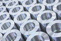 Precision machine parts pattern closeup of shiny circular stainless steel industrial arranged in rows Royalty Free Stock Photo