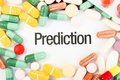 Prediction text between pills colored drugs sales concept Royalty Free Stock Photography