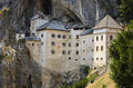 Predjama castle slovenia characteristic and imposing perched on a mountainside Stock Image