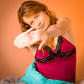 Preety woman stretching arms after waking up in early morning cosy bedroom Stock Photos