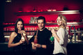 Preety young people drink cocktail in a night club Royalty Free Stock Photo