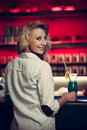 Preety young woman drinks cocktail in a night club Royalty Free Stock Photo