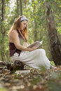 Pregnancy book a pregnant woman in a beautiful forest in autumn Stock Photography