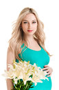 Pregnancy with flowers young pregnant woman on white background Royalty Free Stock Images