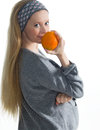 Pregnancy portrait of beautiful pregnant woman with juicy orange Stock Photos