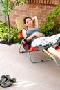 Pregnancy relaxed happy smiling pregnant young caucasian woman lying in outdoor chair outdoor Royalty Free Stock Photo