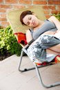Pregnancy relaxed happy smiling pregnant young caucasian woman lying in outdoor chair outdoor Stock Images