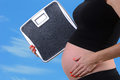 Pregnancy weight gain scale and during concept Stock Images