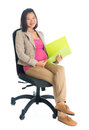 Pregnant asian business woman working full body six months businesswoman holding file folder document seated on chair isolated on Stock Photos