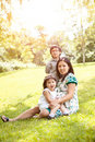 Pregnant Asian mother and her kids Royalty Free Stock Photo