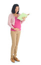 Pregnant asian woman reading book full body six months a standing isolated on white background Royalty Free Stock Image