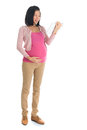 Pregnant asian woman using computer tablet full body six months digital pc standing isolated on white background Royalty Free Stock Photography