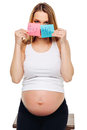 Pregnant belly boy and girl pictures on stickers woman expecting baby family and parenting concept young pregnant with a Royalty Free Stock Photo
