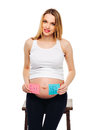 Pregnant belly boy and girl pictures on stickers woman expecting baby family and parenting concept young pregnant with a Royalty Free Stock Photography
