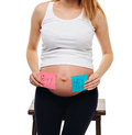 Pregnant belly boy and girl pictures on stickers, woman expecting baby, family and parenting concept.  young pregnant Royalty Free Stock Photo