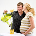 Pregnant couple and flower Royalty Free Stock Photography