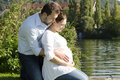 Pregnant couple hugging Stock Image